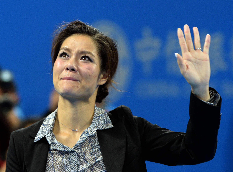Na Li chorou em homenagem na China Foto: Goh Chai Hin/AFP