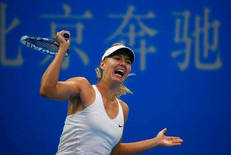 Maria Sharapova of Russia reacts after winning a game during her women's singles match against Elina Svitolina of Ukraine at the China Open tennis tournament in Beijing September 30, 2014. Foto: Petar Kujundzic/Reuters