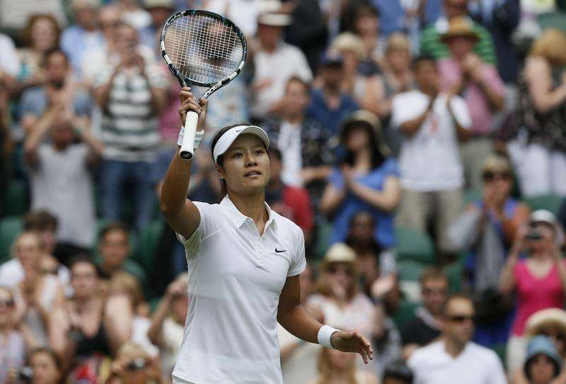 Li Na of China reacts after defeating Paula Kania of Poland in their women's singles tennis match at the Wimbledon Tennis Championships, in London June 23, 2014. Foto: Stefan Wermuth/Reuters