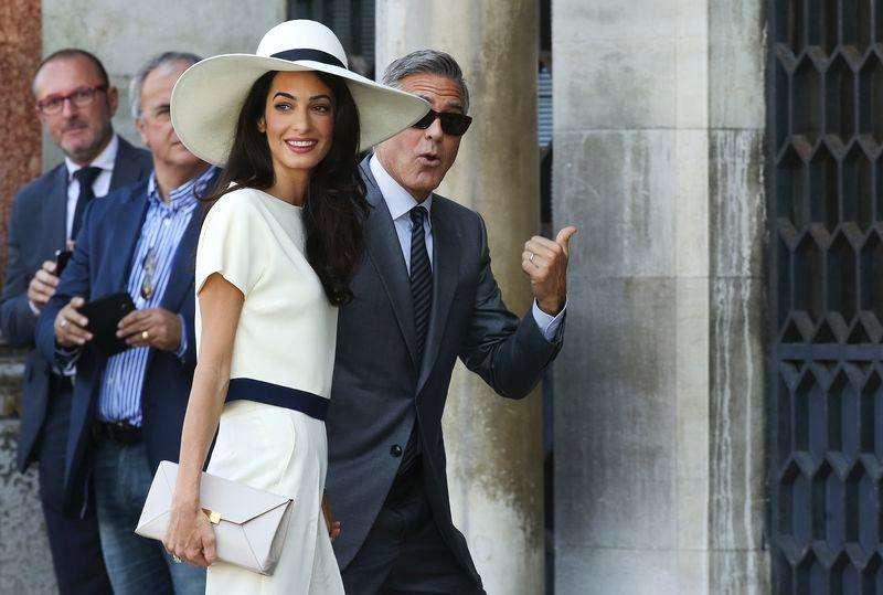 George Clooney e sua mulher, Amal Alamuddin, chegam para casamento civil em Veneza. Foto: Alessandro Bianchi/Reuters