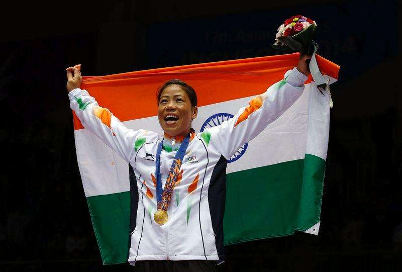 India's gold medallist Chungneijang Mary Kom Hmangte reacts during the medal ceremony for the women's fly (48-51kg) boxing competition at the Seonhak Gymnasium during the 17th Asian Games in Incheon October 1, 2014. Foto: Kim Kyung-Hoon/Reuters