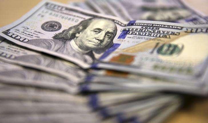 Notas de dólares. Foto: Siphiwe Sibeko/Reuters