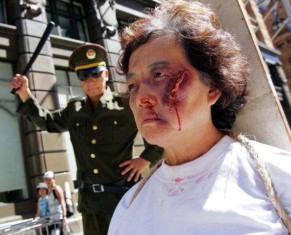 Protesta (realizada en Australia) en contra de los métodos de tortura implementados por autoridades chinas Foto: TORSTEN BLACKWOOD /Getty Images/AFP