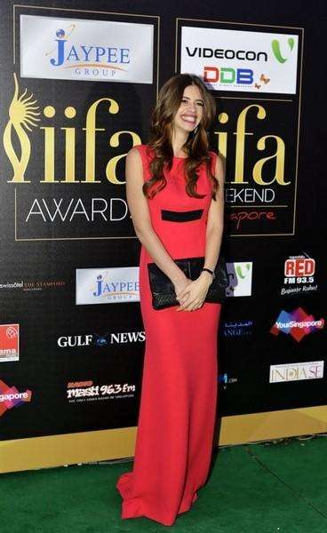 Bollywood actress Kalki Koechlin poses as she arrives on the green carpet for the International Indian Film Academy (IIFA) Awards show in Singapore June 9, 2012. Foto: Tim Chong/Reuters