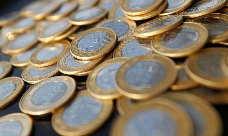 O governo brasileiro pode reduzir a meta de superávit primário para 2015 a um número mais factível, disseram à Reuters nesta quinta-feira três fontes envolvidas nas discussões sobre a política fiscal. Foto: Bruno Domingos/Reuters