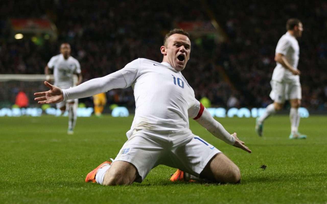 Wayne Rooney celebra el primero de sus dos goles, en el triunfo de Inglaterra 3-1 sobre Escocia. Foto: AFP