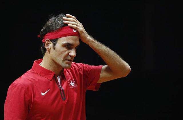 Federer no puede creer la derrota ante Monfils. Foto: Getty Images