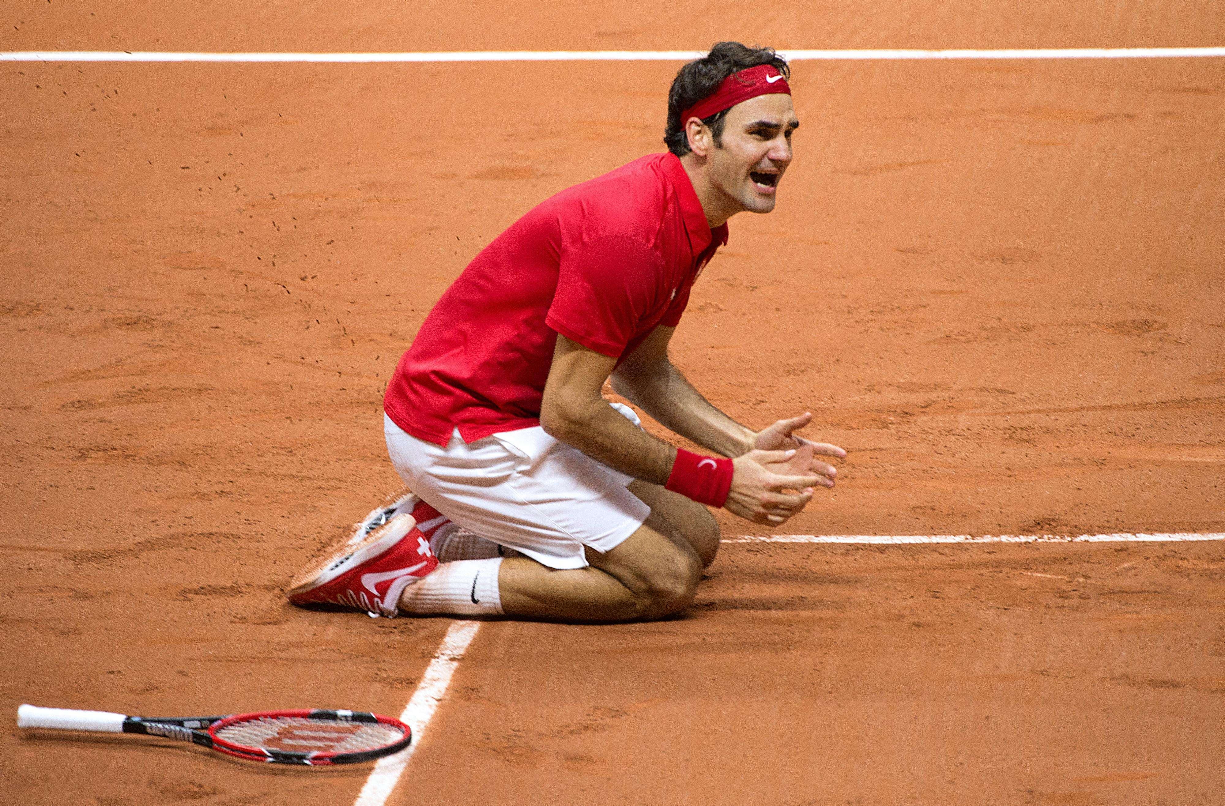 Federer se emocionou com o título Foto: Denis Charlet/AFP