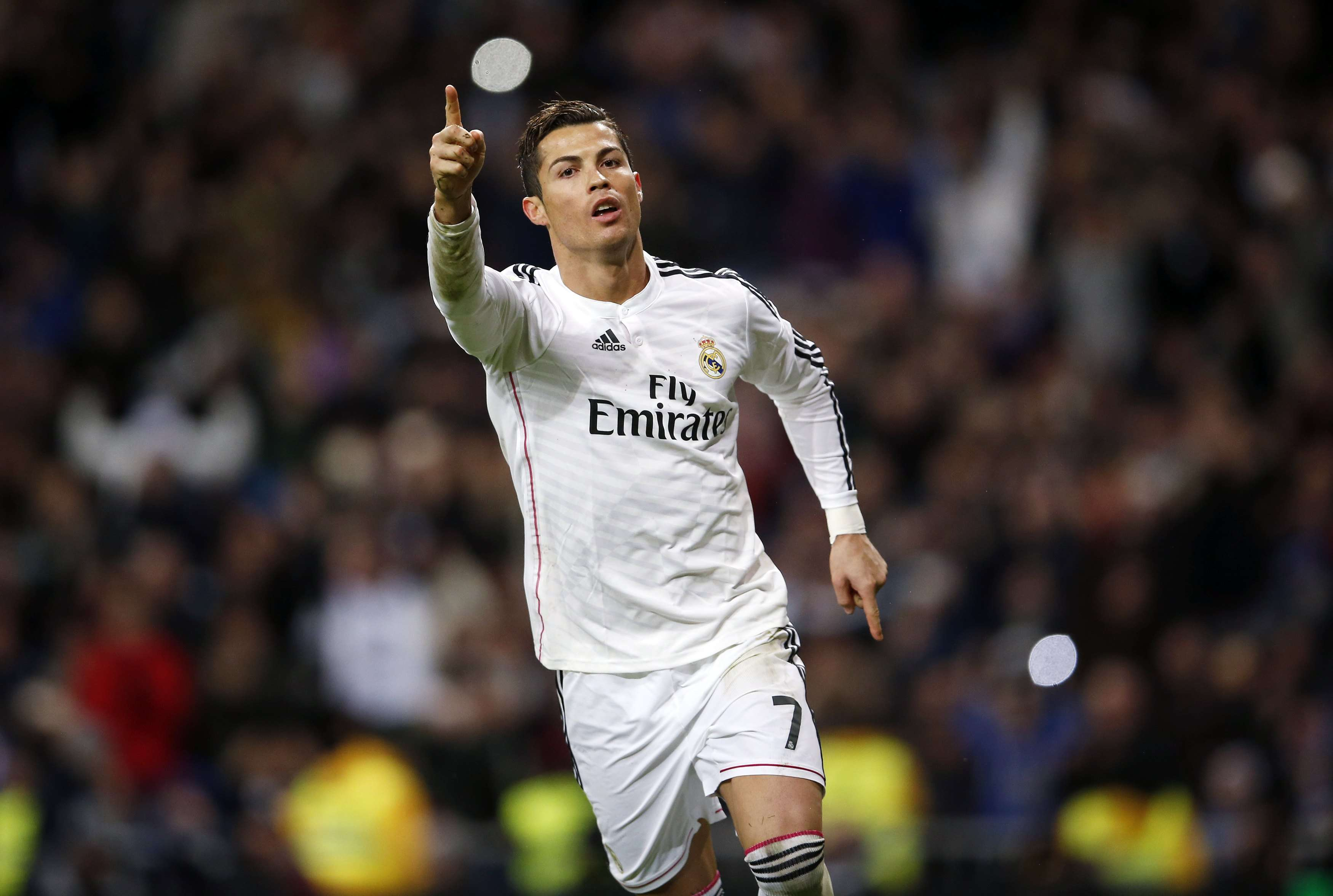 Real Madrid's Cristiano Ronaldo celebrates his goal against Celta Vigo during their Spanish First Division soccer match at Santiago Bernabeu stadium in Madrid December 6, 2014. REUTERS/Andrea Comas (SPAIN - Tags: SPORT SOCCER) Foto: ANDREA COMAS/REUTERS