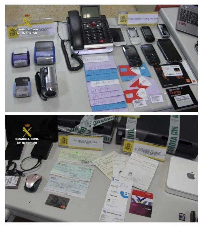 Fotografías facilitadas por la Guardia Civil que ha detenido en Barcelona a seis personas que ha estafado unos 114.000 euros a cerca de 65.000 usuarios de telefonía de toda España. Foto: EFE en español
