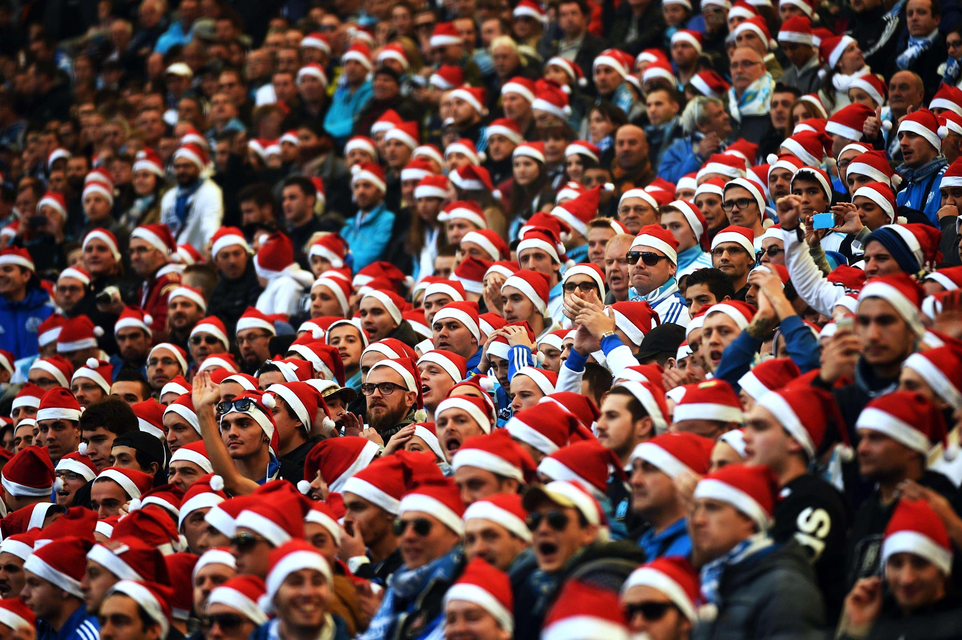 Torcida comemorou vitória, liderança e o Natal Foto: Anne Christine Poujoulat/AFP