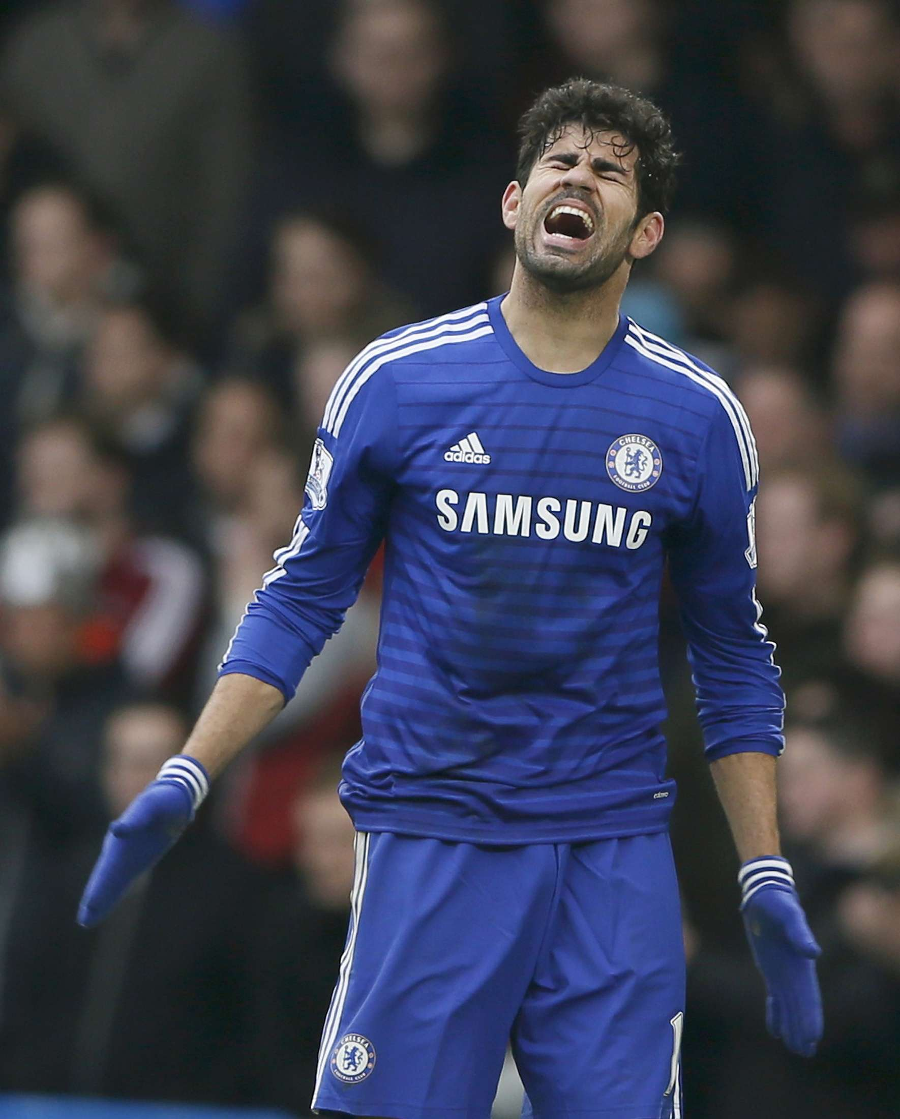 Chelsea's Diego Costa reacts during their English Premier League soccer match against West Ham United at Stamford Bridge in London, December 26, 2014. REUTERS/Stefan Wermuth (BRITAIN - Tags: SOCCER SPORT) FOR EDITORIAL USE ONLY. NOT FOR SALE FOR MARKETING OR ADVERTISING CAMPAIGNS. EDITORIAL USE ONLY. NO USE WITH UNAUTHORIZED AUDIO, VIDEO, DATA, FIXTURE LISTS, CLUB/LEAGUE LOGOS OR 'LIVE' SERVICES. ONLINE IN-MATCH USE LIMITED TO 45 IMAGES, NO VIDEO EMULATION. NO USE IN BETTING, GAMES OR SINGLE CLUB/LEAGUE/PLAYER PUBLICATIONS. Foto: STEFAN WERMUTH/REUTERS