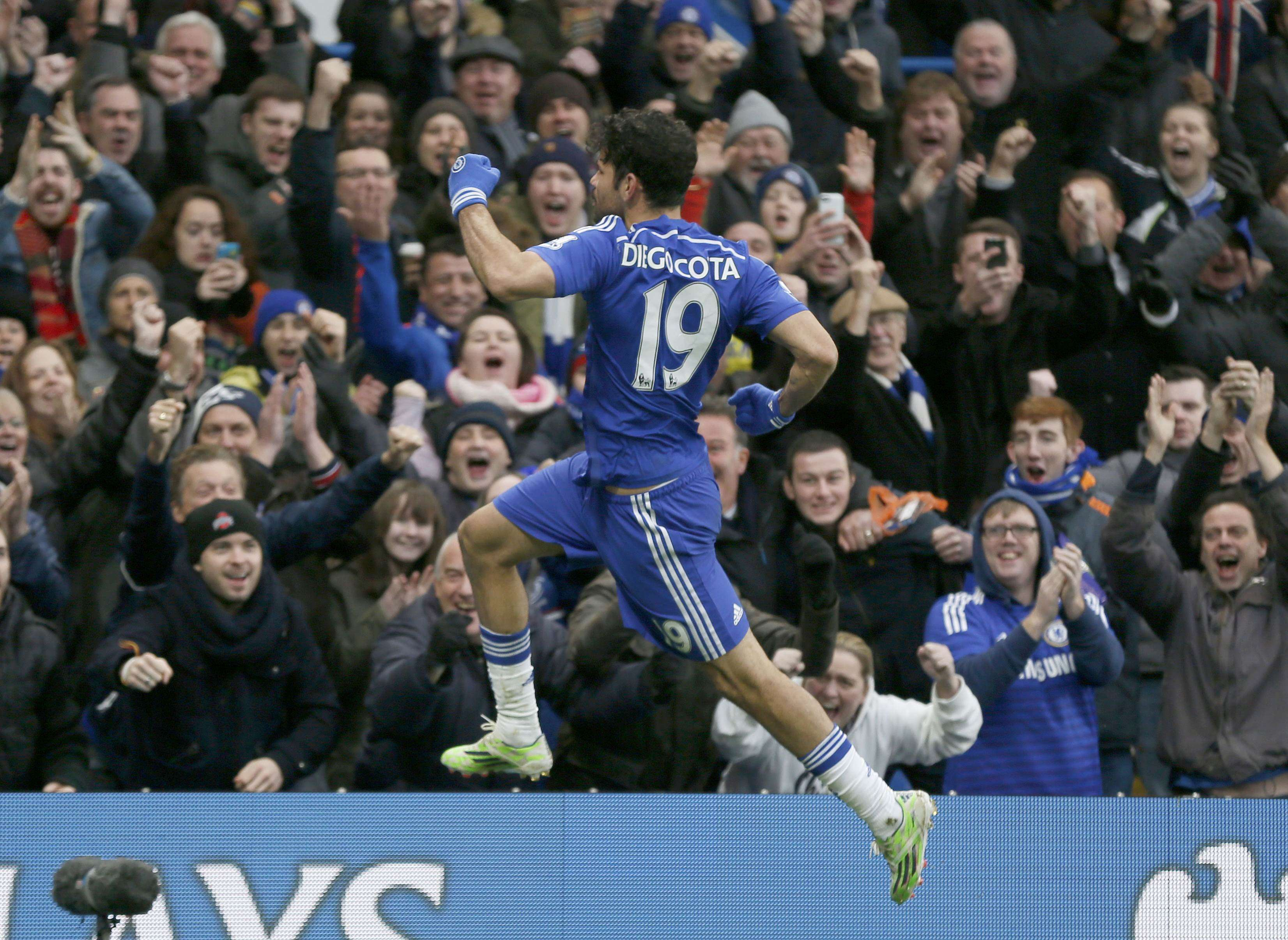 Chelsea's Diego Costa celebrates after scoring a goal against West Ham United during their English Premier League soccer match at Stamford Bridge in London, December 26, 2014. REUTERS/Stefan Wermuth (BRITAIN - Tags: SOCCER SPORT) FOR EDITORIAL USE ONLY. NOT FOR SALE FOR MARKETING OR ADVERTISING CAMPAIGNS. EDITORIAL USE ONLY. NO USE WITH UNAUTHORIZED AUDIO, VIDEO, DATA, FIXTURE LISTS, CLUB/LEAGUE LOGOS OR 'LIVE' SERVICES. ONLINE IN-MATCH USE LIMITED TO 45 IMAGES, NO VIDEO EMULATION. NO USE IN BETTING, GAMES OR SINGLE CLUB/LEAGUE/PLAYER PUBLICATIONS. Foto: STEFAN WERMUTH/REUTERS