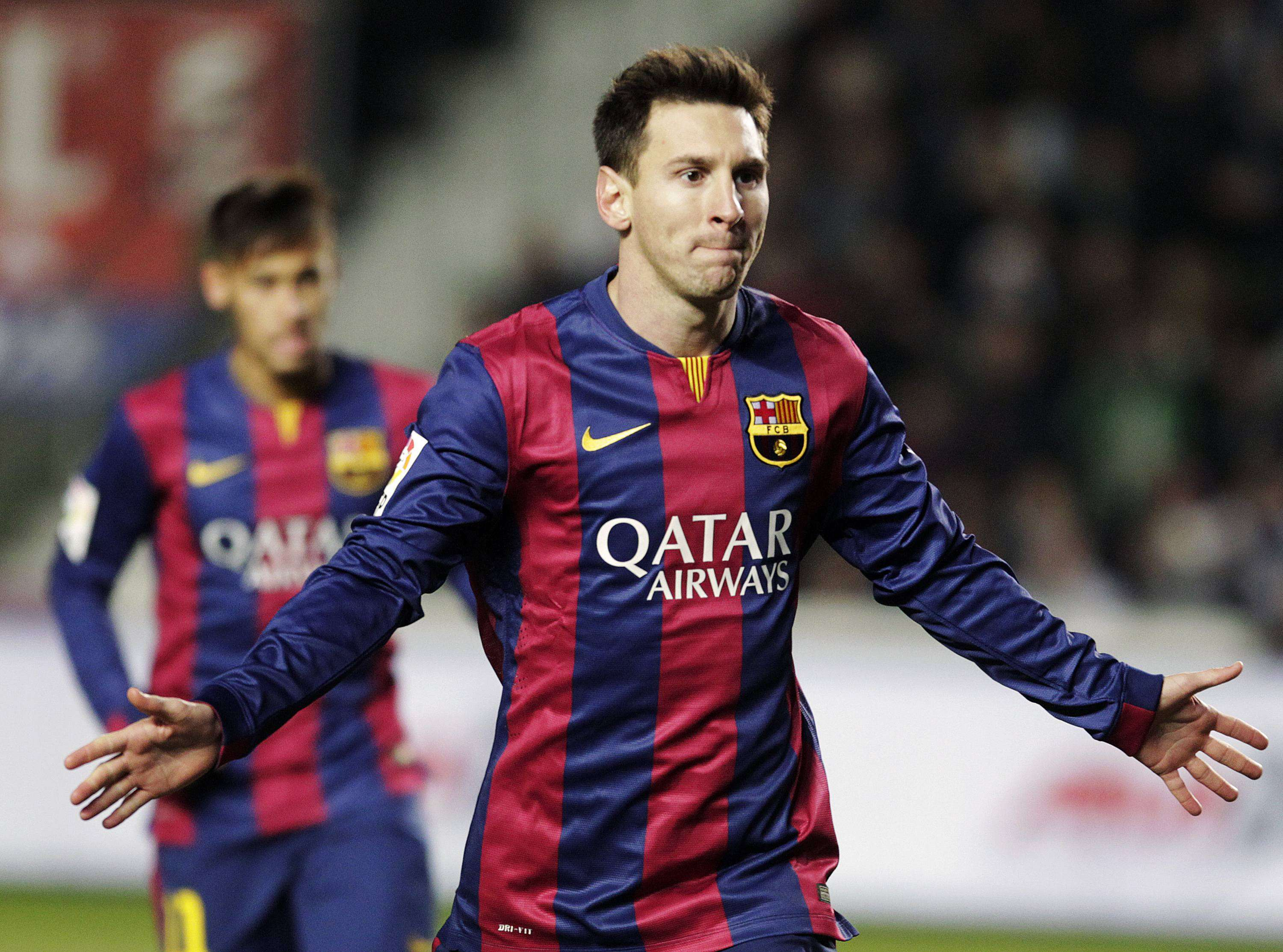 Barcelona's Lionel Messi celebrates after he scored a penalty against Elche during their Spanish first division soccer match at Martinez Valero stadium in Elche January 24, 2015. REUTERS/Heino Kalis (SPAIN - Tags: SPORT SOCCER) Foto: HEINO KALIS/REUTERS