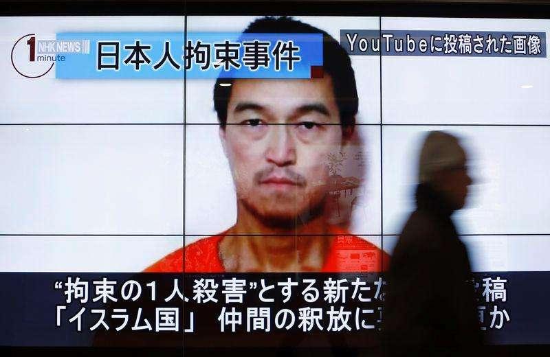 Telão mostra imagem de Goto, jornalista mantido refém pelo Estado Islâmico. 25/1/2015 Foto: Yuya Shino/Reuters