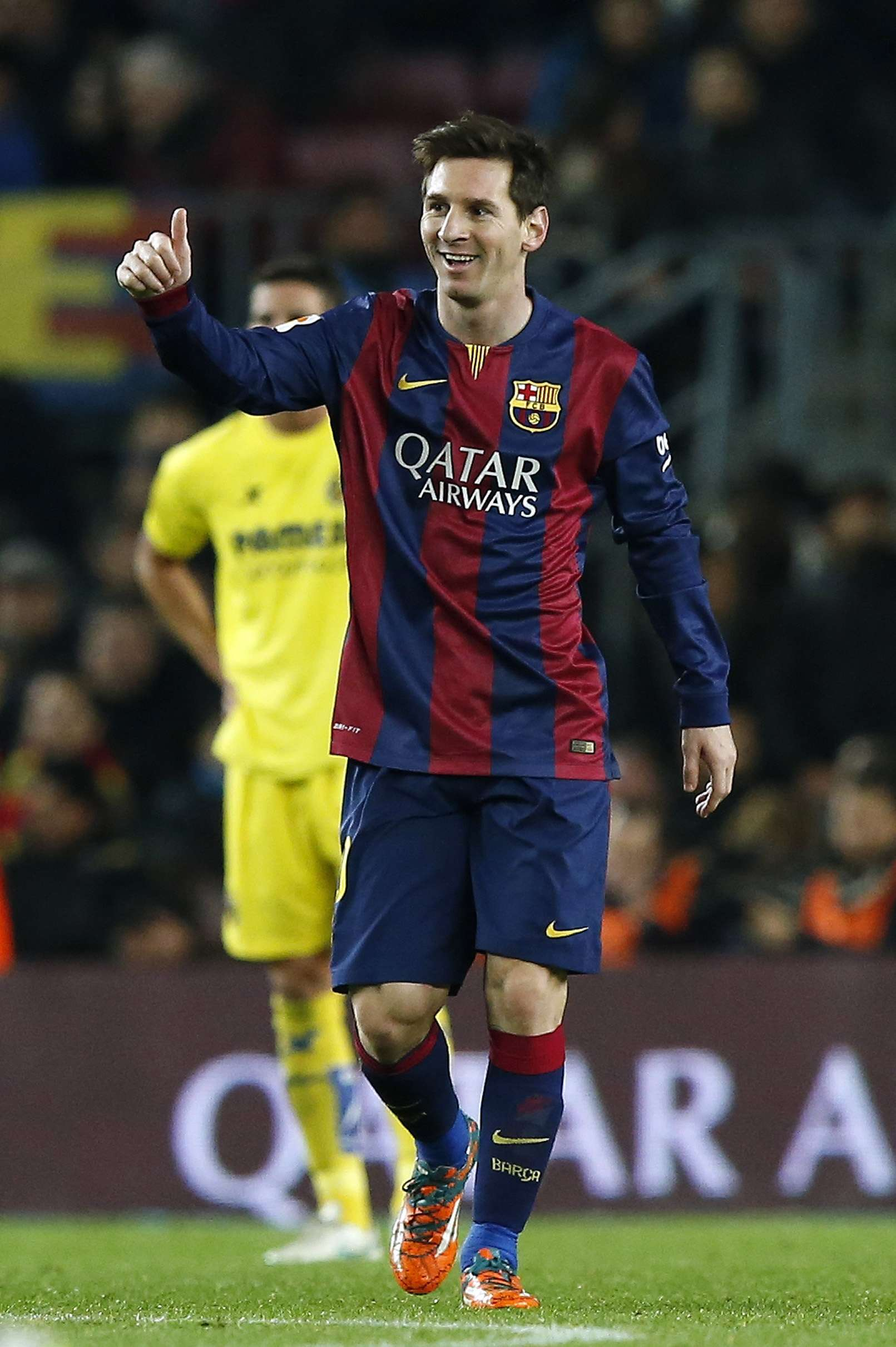 Barcelona's Lionel Messi celebrates his goal against Villarreal during their King's Cup semi-final first leg soccer match at Nou Camp stadium in Barcelona February 11, 2015. REUTERS/Gustau Nacarino (SPAIN - Tags: SPORT SOCCER) Foto: GUSTAU NACARINO/REUTERS