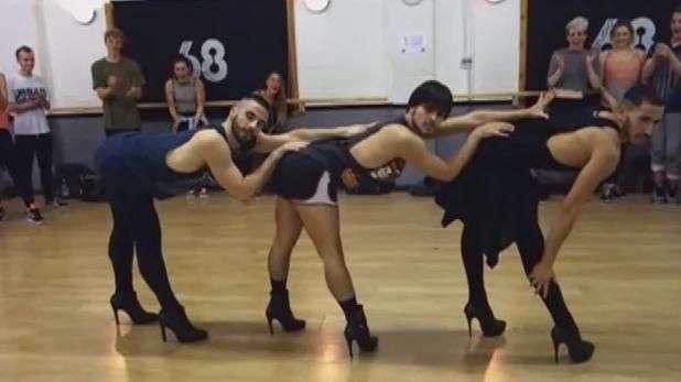 Bailarines se lucen usando tacones en coreografía