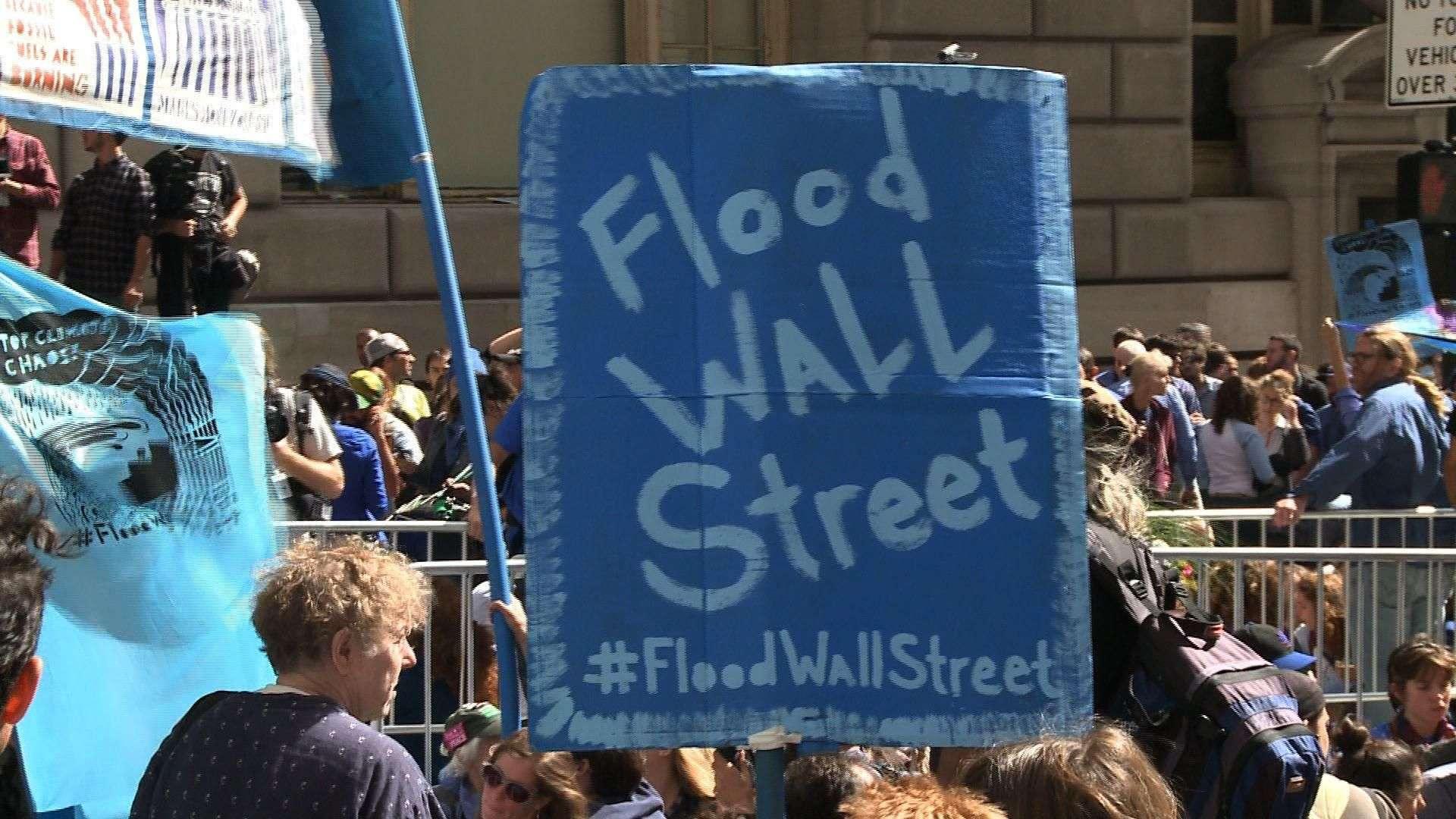Miles protestan contra cambio climático en Wall Street