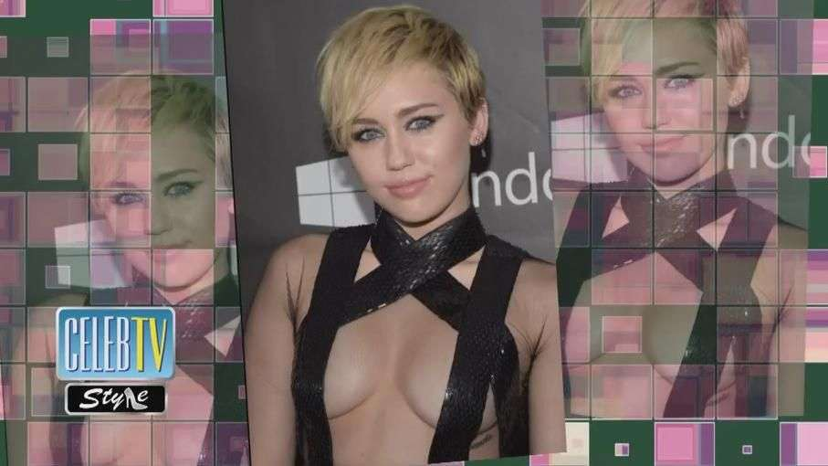 Miley Cyrus strategically placed straps on her upper half