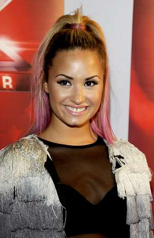 """OAKLAND, CA - JUNE 16: Demi Lovato attends Fox's """"The X Factor"""" Season 2 Auditions at Oracle Arena on June 16, 2012 in Oakland, California. (Photo by Tim Mosenfelder/Getty Images) Foto: Getty Images"""