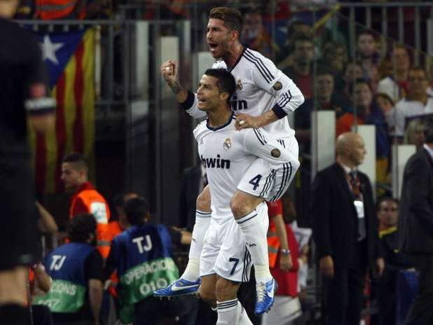 Real Madrid's Cristiano Ronaldo celebrates with teammate Sergio Ramos (top) after scoring against Barcelona during their Spanish first division soccer match at Nou Camp stadium in Barcelona, October 7, 2012.  Photo: ALBERT GEA / REUTERS