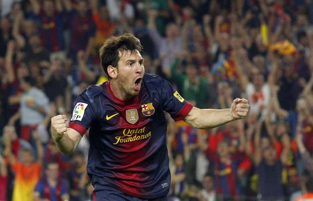 Barcelona's Lionel Messi celebrates after scoring a goal against Real Madrid during their Spanish first division soccer match at Nou Camp stadium in Barcelona, October 7, 2012.    Photo: ALBERT GEA / REUTERS
