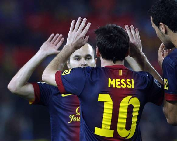 Barcelona's Lionel Messi (C) celebrates with teammate Andres Iniesta after scoring against Real Madrid during their Spanish first division soccer match at Nou Camp stadium in Barcelona, October 7, 2012.   Photo: ALBERT GEA / REUTERS