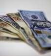 Dólar sobe mais de 1% ante real com riscos ofuscando intervenção do BC