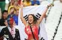 Torcedores da Coreia do Sul e da Bélgica fazem festa nas arquibancadas da Arena Corinthians, em São Paulo, à espera do confronto entre as duas seleções