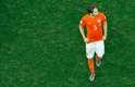 Os jogadores da Holanda lamentaram nesta quarta-feira a derrota nos pênaltis para a Argentina e o fim do sonho de conquistar a taça. Na foto, Dirk Kuyt e Daley Blind deixam o gramado da Arena Corinthians