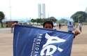 Brasília (DF) - Protestante leva faixa do candidato derrotado na eleição presidencial, Aécio Neves
