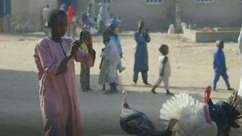 Crianças refugiadas registram vida em acampamento nigeriano