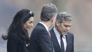 George y Amal Clooney tratan crisis de refugiados con Merkel