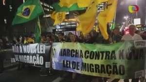 Grupo protesta em São Paulo contra nova lei de imigração