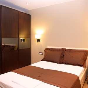 Veja dicas para escolher a melhor posição da cama no quarto