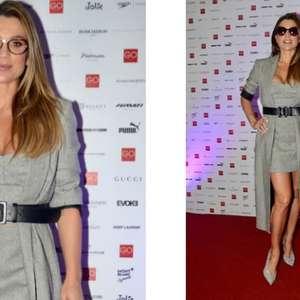 Flávia Alessandra usa cinza com escarpim prata de R$ 3,6 mil