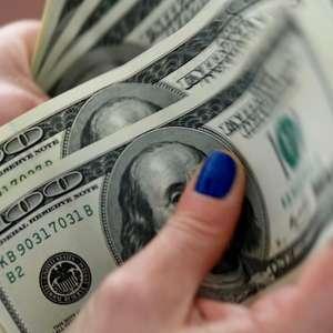 Dólar anula queda e fecha em ligeira alta com dúvidas ...
