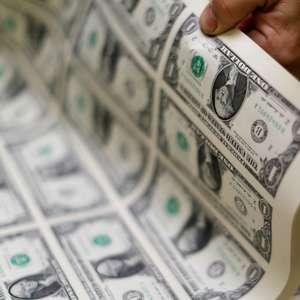Dólar sobe na sessão, mas tem maior queda para novembro ...