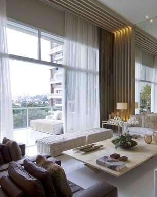 Tons neutros e texturas transformam apartamento em palacete