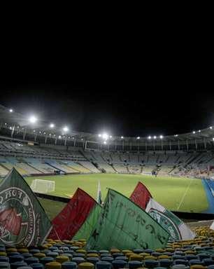 Briga entre torcedores interrompe colocação de faixas e bandeiras do Fluminense antes da Copa do Brasil