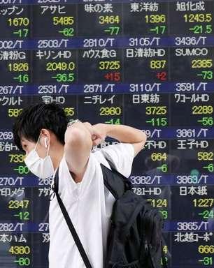 Ações do Japão recuam com temores sobre Evergrande; índice de HK sai de mínima em 1 ano