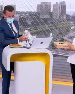 Ana Maria Braga cumpre promessa e entrega comida para Rodrigo Bocardi ao vivo