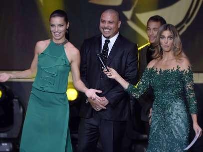 Fernanda Lima teve concorrência de outras belas garotas, como a modelo brasileira Adriana Lima Foto: AFP