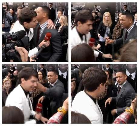 """Esta serie de fotografías, tomada de un video de la AP, muestra el momento en que el actor estadounidense Wil Smith recibe un abrazo del reportero Vitali Sediuk y lo abofetea después de que el periodista trató de besarlo, el viernes 18 de mayo de 2012, antes del estreno de """"Men in Black III"""", en Moscú"""
