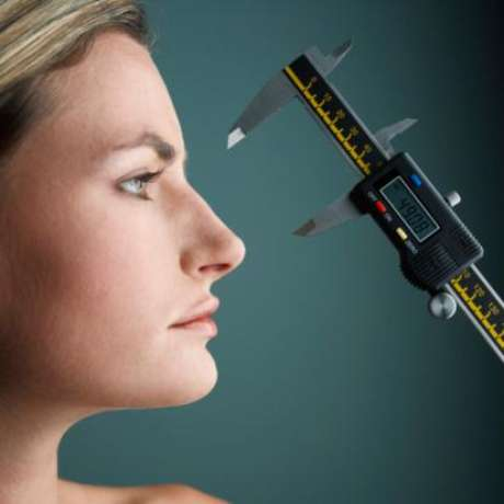 Woman Getting Her Nose Measured