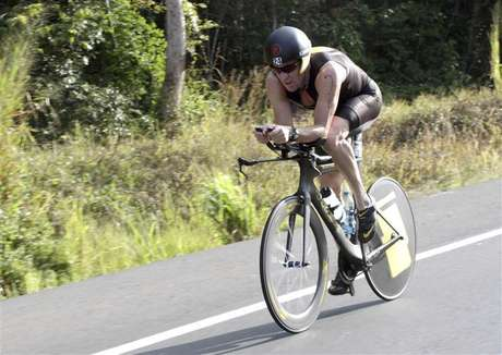 Lance Armstrong of the U.S. cycles during the Ironman Panama 70.3 triathlon in Panama City February 12, 2012. The U.S. Anti-Doping Agency filed formal charges against Armstrong Friday for using performance-enhancing drugs.