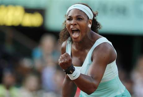 Serena Williams of the U.S. reacts during her match against Virginie Razzano of France during the French Open tennis tournament at the Roland Garros stadium in Paris May 29, 2012. Williams and her sister Venus will be part of the U.S. Olympic tennis team that will compete in London next month.