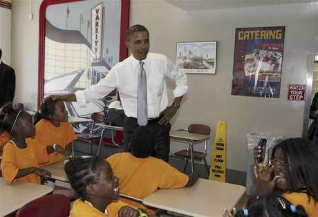 U.S. President Barack Obama talks to children inside the Varsity restaurant in Atlanta, Georgia, June 26, 2012.