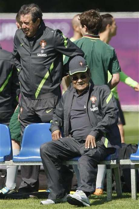 Former Portugal national soccer player Eusebio (R) watches a Portugal training session during the Euro 2012 at a training field in Opalenica June 15, 2012.