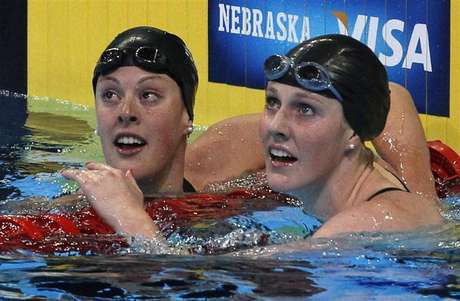 Allison Schmitt (L) and Missy Franklin check their times after their women's 200m freestyle semifinal during the U.S. Olympic swimming trials in Omaha, Nebraska, June 27, 2012.